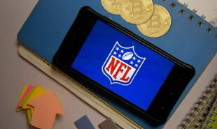 NFL logo on a mobile screen with bitcoins signifying digital currencies