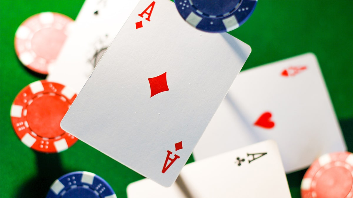 Zoomed photo of poker cards and chips thrown in the air