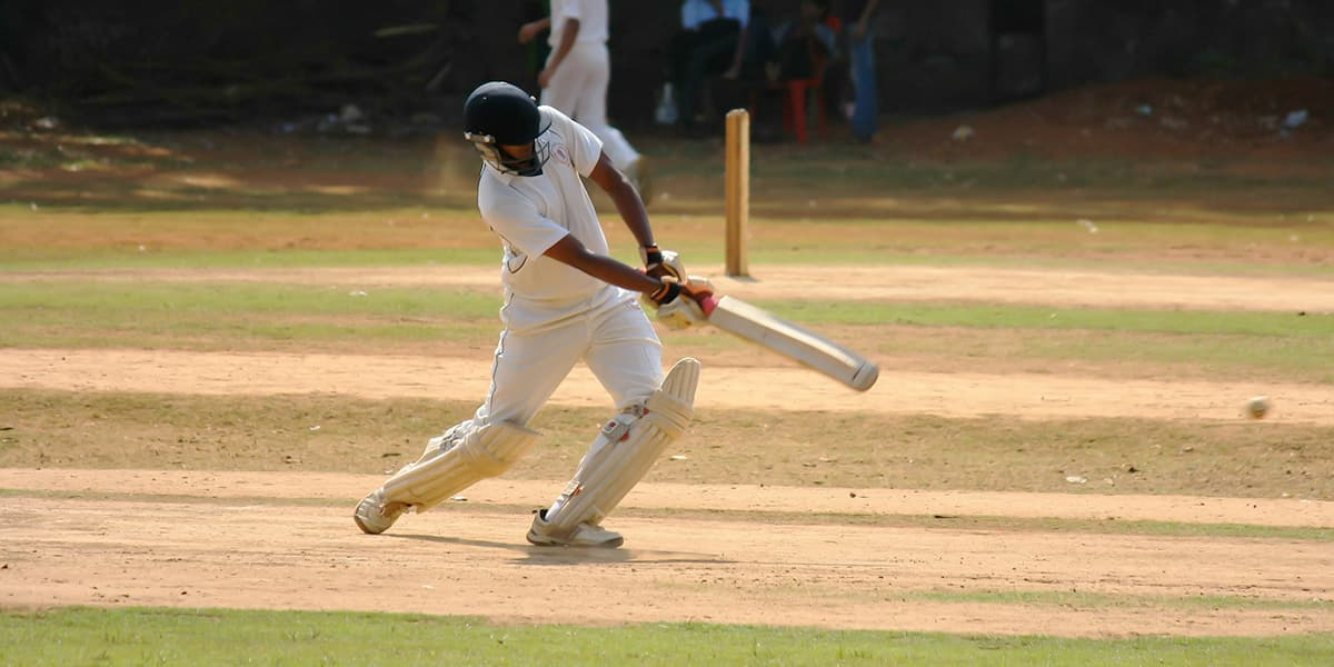 A cricket player hitting the ball