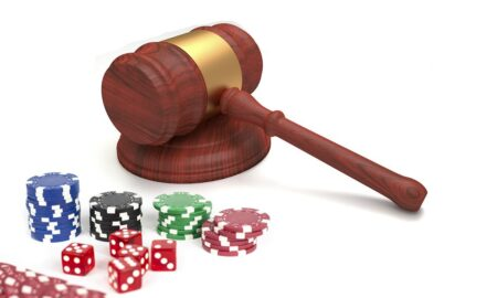 Gavel and casino chips and dice