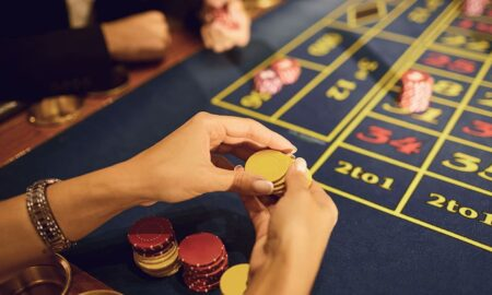 People play casino poker at a table in a casino