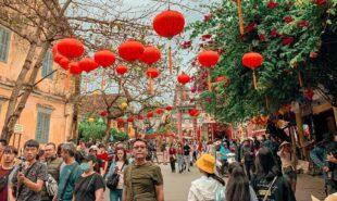 People Walking on Street under Chinese lanterns