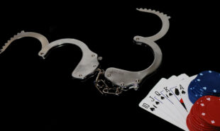 Open handcuffs and casino chips and playing cards