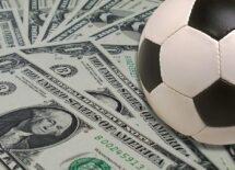US dollars and a soccer ball
