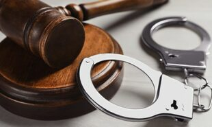 Brown gavel and handcuffs