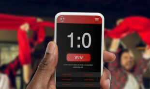 Device screen with mobile app for betting and score.