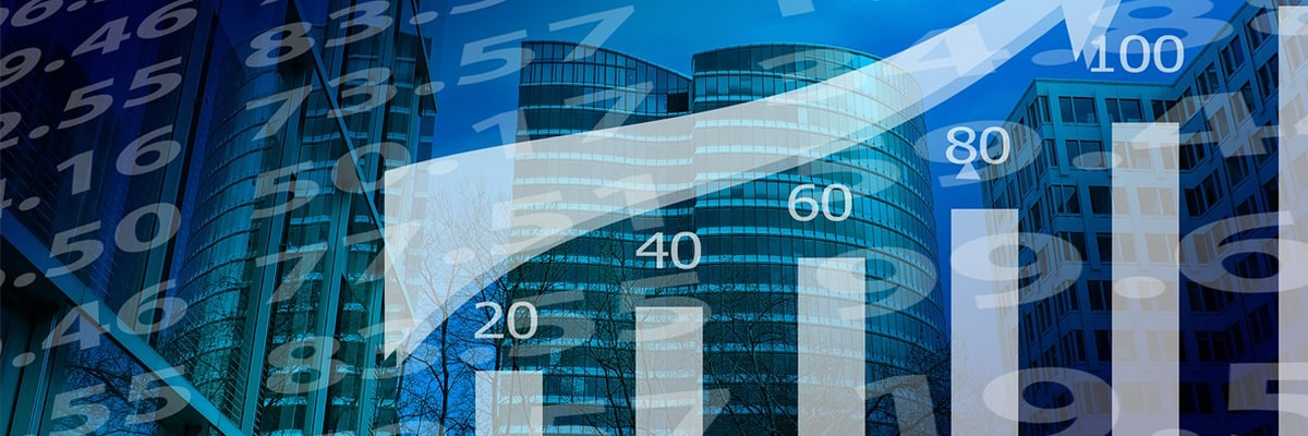 Stocks charts on a background of business buildings