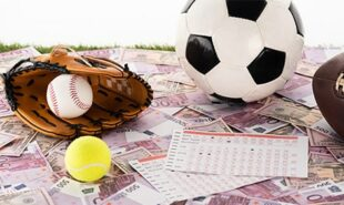 baseball glove and ball, soccer, tennis and rugby balls near betting lists on euro and dollar banknotes