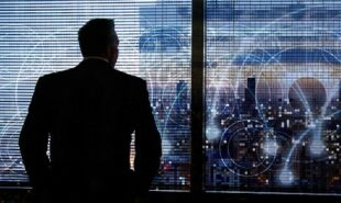 businessman looking over evening skyline with data concept