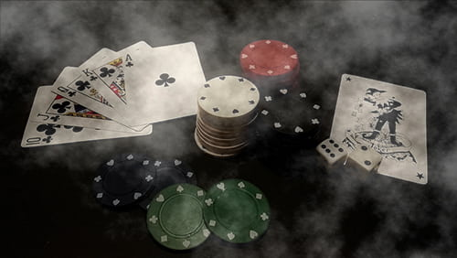 Foggy table with casino gaming materials