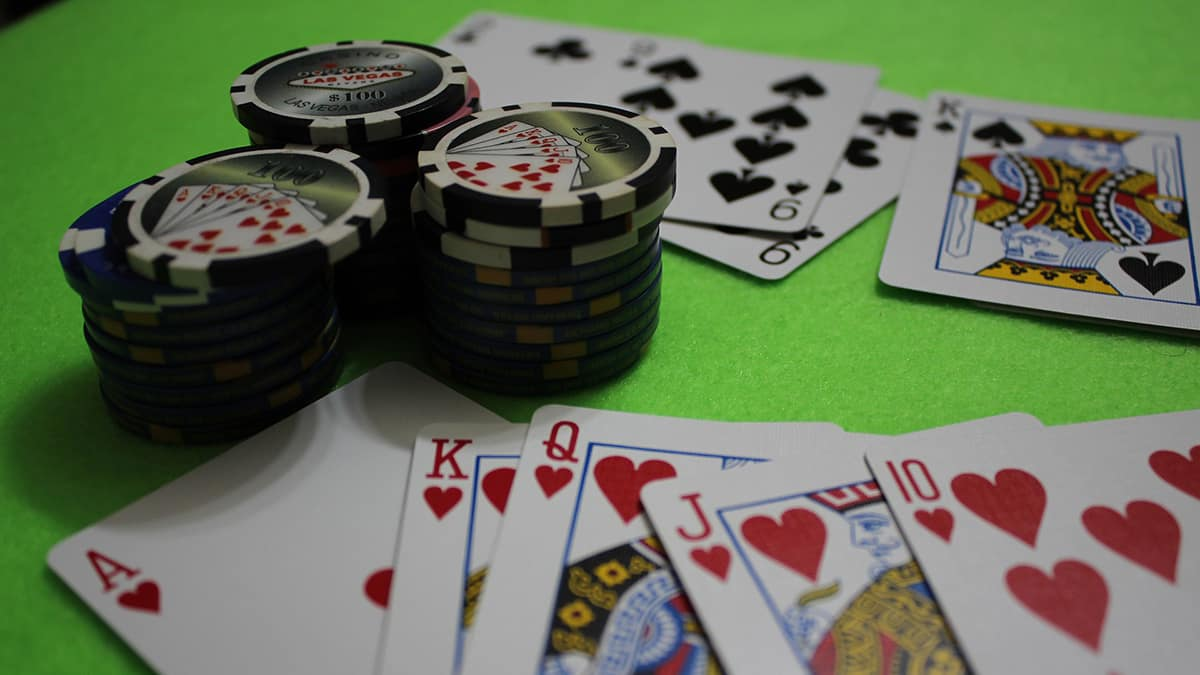 Casino chips and cards on a green table