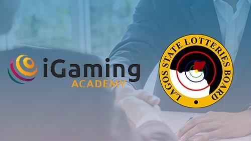 iGaming Academy dan logo LSLB dengan latar belakang pebisnis berjabat tangan