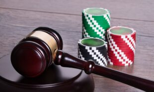 Casino chips and gavel in gambling legal concept
