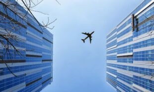 Airplane on top of two buildings